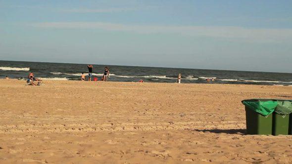Sea Water Waves And Sandy Beach