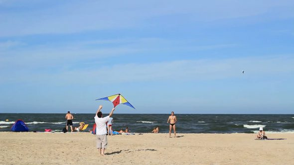 Guys Practicing With A Kite On A Beach 2
