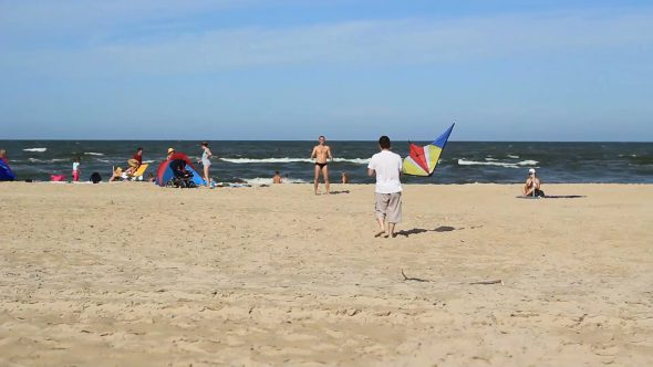 Guys Practicing With A Kite On A Beach 3