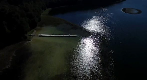 Flight Over The Small Bridge On The Lake Near Forest At Evening Night