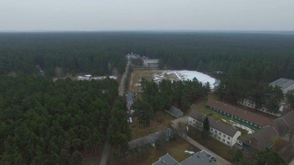 Flight Over Buildings Near Forest 2