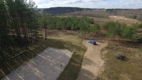 Flying Away From Gravel Road In Country
