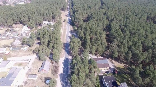 Flight Over Small Town Near Forest 2