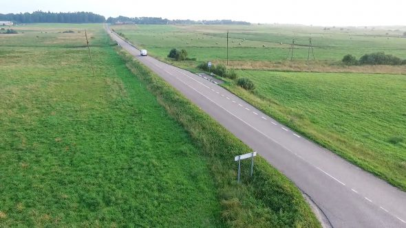 Country Road From Above With Passing Cars